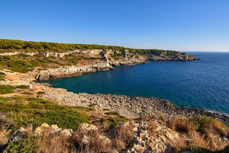 Bay of Torre Uluzzo Coastline in the Regional Park of Porto Selvaggio in Apulia At The End Of An Autumn Day