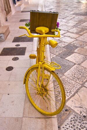 Vintage Yellow Bike Serving As A Decoration In An Italian Street