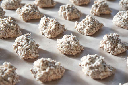 Hazelnut And Coconut Dough Intended For Cookie Cooking On A Sheet Of Baking Paper Stock fotó