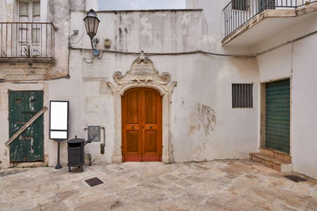 Blank tourist sign mockup and vintage trash can on a street in Southern Italy
