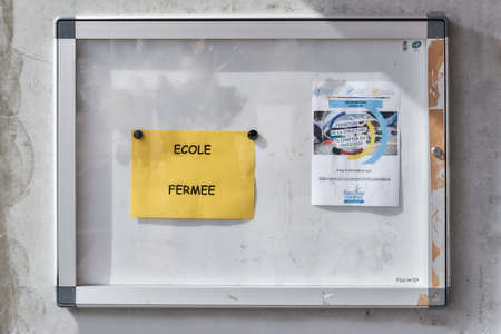 Granges Narboz Franche Comte France March 2020: Poster panel contains posters announcing the closure of schools and extracurricular structures during lock down