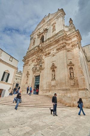 Martina Franca Apulia Italy November 2019: Tourists And Locals Gather Around Basilica of San Martino in Piazza Plebiscito, province of Taranto, Apulia in southern Italy Sajtókép