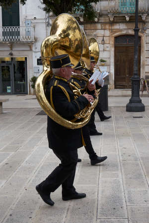Martina Franca Apulia Italy November 2019: Musicians play the tuba as a procession parades through the streets during the ceremonies of November 1st on the occasion of All Saints' Day