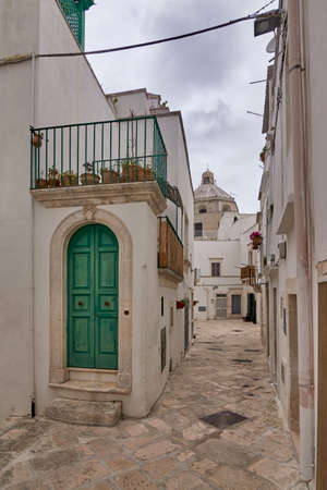 Typical Street Scene Of The Historical Center of Martina Franca, A Village In Puglia, Apulia, Italy On A Cloudy Rainy Day