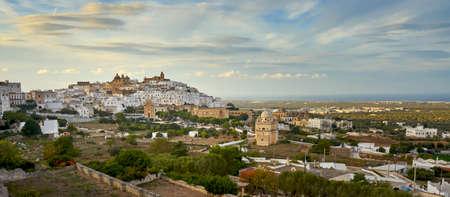 Panoramic View of Ostuni white town skyline and Madonna della Grata church Brindisi Apulia southern Italy Europe