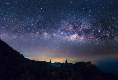 Horizintal milkyway in starry night on top of inthanon mountain with pagoda