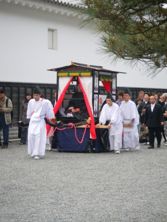 Kyoto, Japan, April 23, 2010-Traditional Japanese wedding at Nijo Castle. One of the 65 couples married at Nijo Castle in 2010 being carried in a Rikisha (Japanese wooden cart), hand-made by 30 traditional craftsmen in Kyoto.