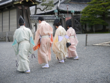 Kyoto, Japan, April 23, 2010-Priest and musicians follow a traditional Japanese wedding procession in Nijo Castle.