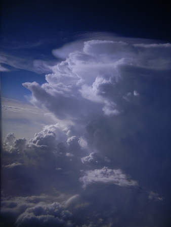 Dynamic formations of towering cumulus clouds high in the atmosphere
