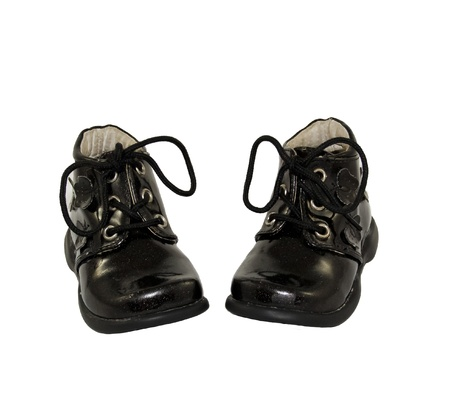 patent leather: cute black baby shoes isolated on white background