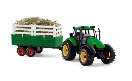 tractor with hay inside of cargo trailer isolated on white background