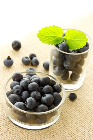 balm: Blueberries in glass containers with lemon balm