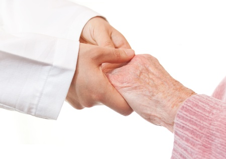 touching: Doctor Holding Seniors Hands