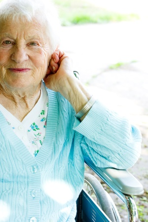 aging woman: Beautiful senior lady in wheelchair in spring day