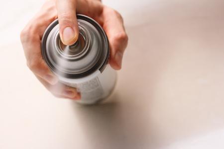 Hand spraying white spray paint Stok Fotoğraf