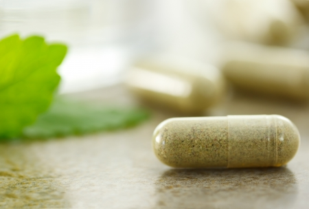 Close up of herbal medicine in capsules Stock Photo - 9877319