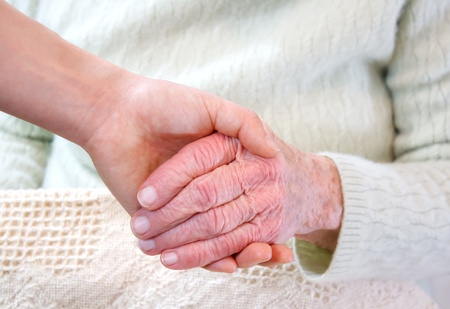 Young holding senior woman Imagens