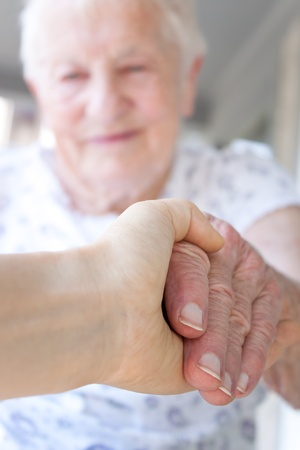 Young hand holding senior lady Stock Photo - 10010432