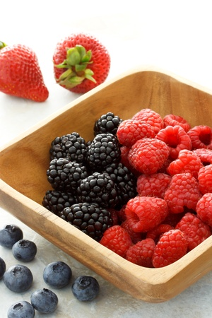 Assorted fresh berries on wooden bowl Stock Photo - 10010437