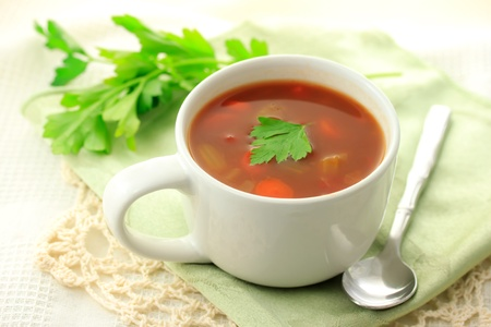 minestrone: Minestrone soup in a cup with parsley