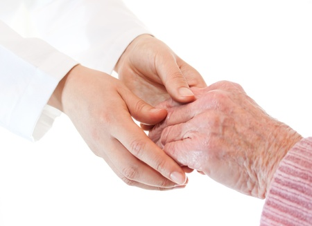 Doctor holding senior ladys hands photo