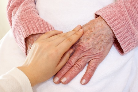 Old and Young Hands on White Blanket Stock Photo - 10527334