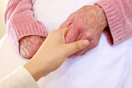 Old and Young Hands on White Blanket Stock Photo - 10527333