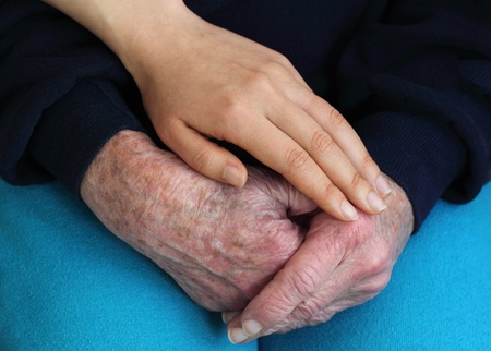 retirement  age: Young holding seniors hands Stock Photo