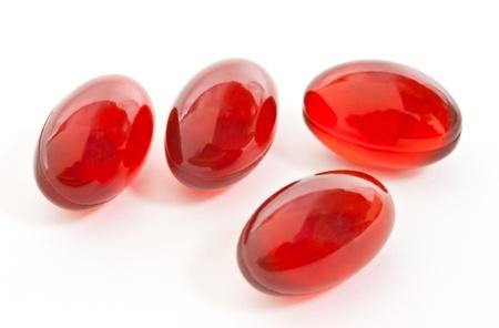 capsula: C�psulas de gelatina roja Foto de archivo