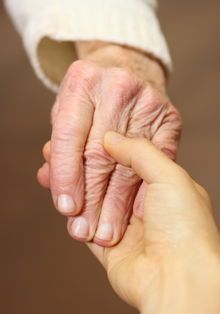 loving hands: Senior and young women holding hands