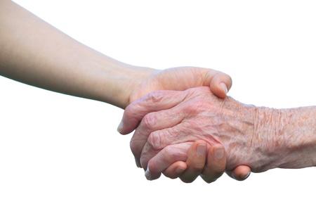 Senior en jonge handen op witte achtergrond