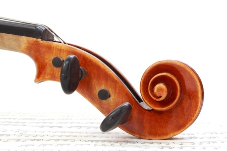 Violin Scroll on Sheet Music Stock Photo