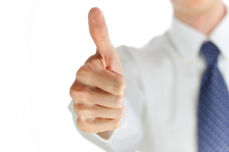 Young businessman showing thumb up photo