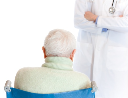 Doctor with Senior Woman in Wheelchair photo