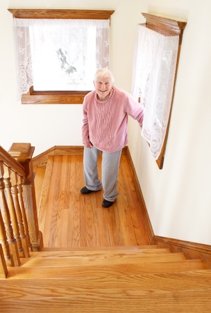 Senior woman infront of staircase Stock Photo - 10580114