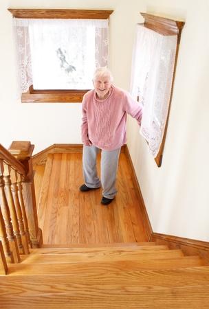 Senior woman infront of staircase Stock Photo - 10580114
