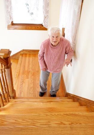 Senior woman infront of staircase photo