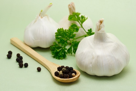 Food ingredients - garlic, parsley and peppercorn