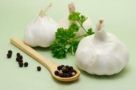 Food ingredients - garlic, parsley and peppercorn