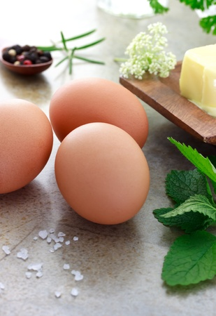 peppercorn: Eggs with rosemary, parsley, mint, peppercorn and butter Stock Photo