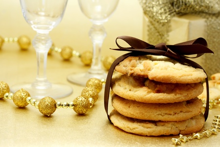 Christmas cookies with wine glasses and gift box photo