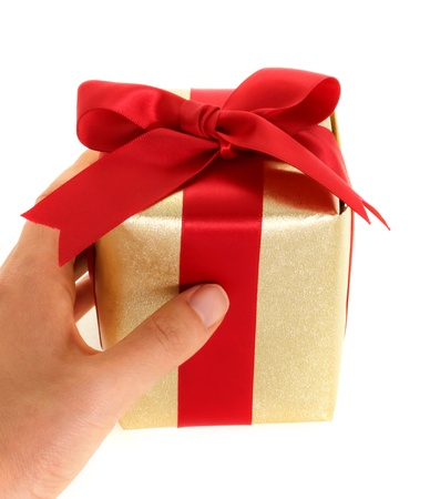 Hand holding gift box on white background Stock Photo - 11028584
