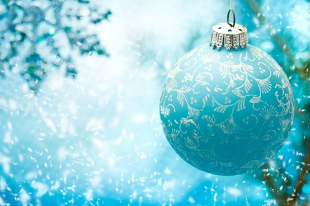 Blue Christmas ornament with snow flakes photo