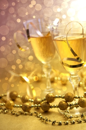 Christmas champagne with beads - gold and purple shiny image Stock Photo