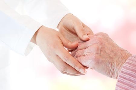 Doctor holding senior lady