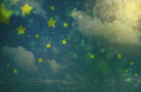 night: Stars and clouds in the night sky in grunge and vintage style