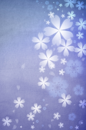 Blue colored cherry blossoms background with fabric pattern photo