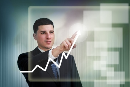 Businessman highlighting business growth on a graph photo