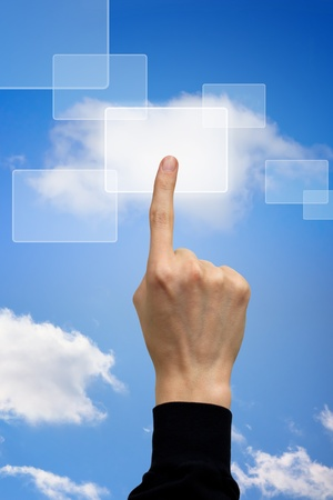 hand pushing the cloud computing button  photo