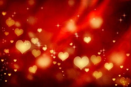 Golden shiny hearts on red satin background  photo